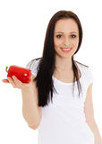 Beautiful young woman with a pepper. Stock Photo