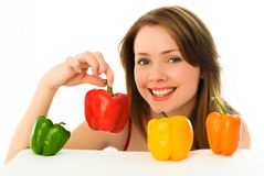 Beautiful young woman with peppers Stock Photo