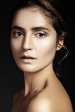 Beautiful young woman with perfect clean shiny skin, natural fashion makeup. Close-up woman, fresh spa look Stock Images