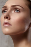 Beautiful young woman with perfect clean shiny skin, natural fashion makeup. Close-up woman, fresh spa look Stock Image