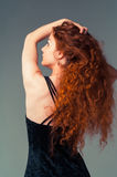 Beautiful young woman with perfect long red hairs looking up on Stock Image