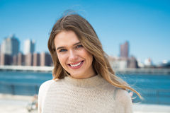 Beautiful young woman with perfect natural white teeth smile at sunny day. Close-up portrait of beautiful young woman with perfect natural white teeth smile at Royalty Free Stock Photos