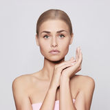 Beautiful young woman. With perfect skin and blond hair Royalty Free Stock Photos