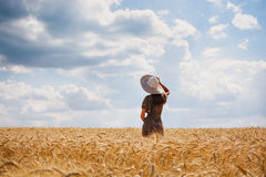 Beautiful young woman on perfect wheat field Royalty Free Stock Photography