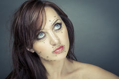 Beautiful young woman with perforation lines on her face before plastic surgery operation Stock Image