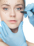 Beautiful young woman with perforation lines on her face before plastic surgery operation. Stock Photography