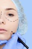 Beautiful young woman perforation lines plastic surgery operatio Stock Photos
