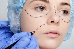 Beautiful young woman perforation lines plastic surgery operatio Royalty Free Stock Photos
