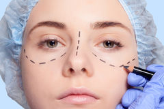 Beautiful young woman  perforation lines plastic surgery operation Royalty Free Stock Photography