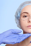Beautiful young woman  perforation lines plastic surgery operation Stock Photos