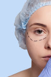 Beautiful young woman  perforation lines plastic surgery operation Stock Photography