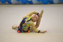 Beautiful young woman performing floor exercise during gymnastics competition Royalty Free Stock Images