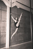 Beautiful young woman performing pole dance elements Stock Photography