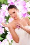 Beautiful young woman with perfume Stock Image