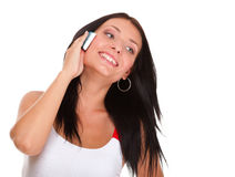 Beautiful young woman with phone isolated Stock Photo