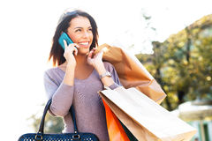 Beautiful young woman on the phone Stock Image