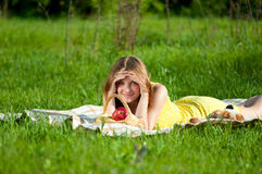 Beautiful young woman on picnic with fruits Royalty Free Stock Photos