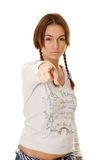 Beautiful young woman with pigtails points his fin Royalty Free Stock Photo
