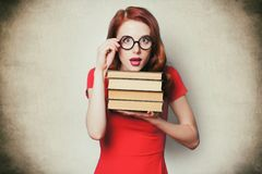 Beautiful young woman with pile of books Stock Images