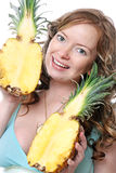 Beautiful young woman with pineapples Royalty Free Stock Photo