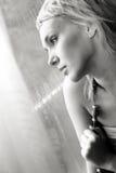 Beautiful young woman pining Royalty Free Stock Image