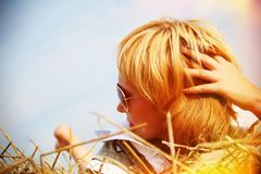 Beautiful young woman pining Stock Image