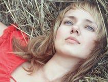 Beautiful young woman pining Royalty Free Stock Photography