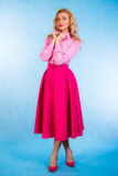 Beautiful young woman in pink clothes Stock Image