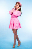 Beautiful young woman in pink clothes with a wreath Stock Photography