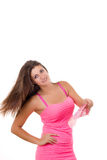 Beautiful young woman in pink dress with a fan Stock Photo