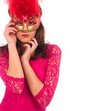 Beautiful young woman in a pink dress and red mysterious venetian mask Royalty Free Stock Photo