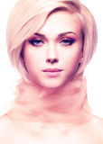 Beautiful young woman with pink fabric. Royalty Free Stock Photography