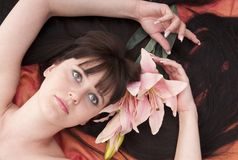 Beautiful young woman with pink flower. Portrait beautiful young woman with pink flower stock photos
