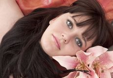Beautiful young woman with pink flower. Portrait beautiful young woman with pink flower royalty free stock photo