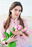Beautiful young woman with pink flowers bouquet Stock Photos