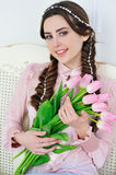 Beautiful young woman with pink flowers bouquet Royalty Free Stock Photo