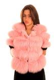 Beautiful young woman in pink fur coat stock photos