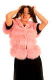 Beautiful young woman in pink fur coat Stock Image