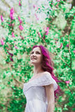 Beautiful young woman with pink hair Stock Images