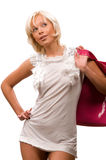 Beautiful young woman with a pink handbag Stock Image