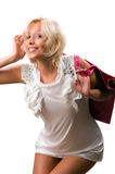 Beautiful young woman with a pink handbag Stock Photography