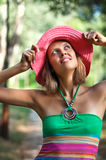 Beautiful young woman in pink hat Stock Photography