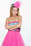 Beautiful young woman in pink looking jealous Stock Photography