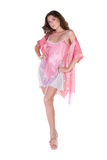 Beautiful young woman in pink nightgown Royalty Free Stock Photos