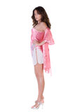Beautiful young woman in pink nightgown Stock Photography