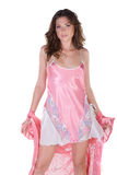 Beautiful young woman in pink nightgown Royalty Free Stock Images