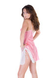 Beautiful young woman in pink nightgown Royalty Free Stock Image