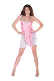 Beautiful young woman in pink nightgown. Isolated over white Stock Image