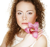 Beautiful  young woman with pink orchid Royalty Free Stock Image