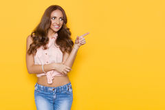 Beautiful Young Woman In Pink Pastel Shirt Is Pointing Royalty Free Stock Photo